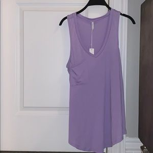 Purple z supply tank with pocket! Never been worn